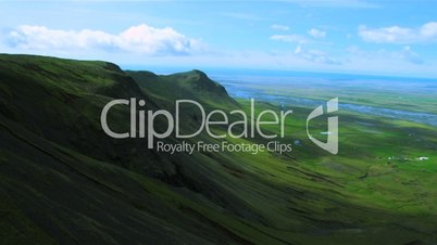 Aerial view of green mountain ridges and fertile plains, Iceland