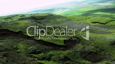 Aerial View of Rugged Icelandic Volcanic Ridges & Grasslands