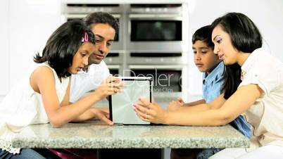 Asian Family Using Wireless Tablet  for Online Video Chat