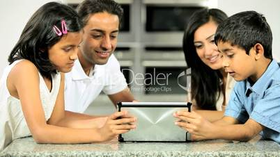Young Asian Family Having Fun with  Wireless Tablet