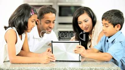 Asian Family Playing on Wireless Tablet