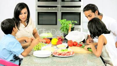Young Asian Family Making Healthy Lunch