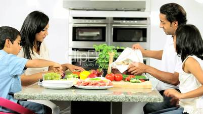 Asian Family Preparing Healthy Meal Together