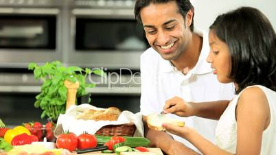 Ethnic Father & Daughter Preparing Food