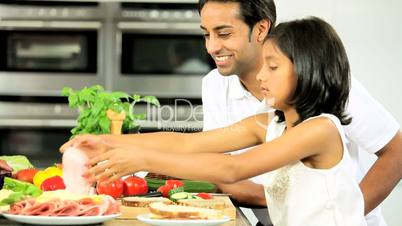 Young Asian Girl & Father Making Lunch