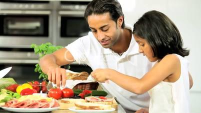 Ethnic Father & Daughter Preparing Food
