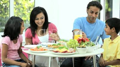 Young Asian Family Eating Healthy Lunch Together