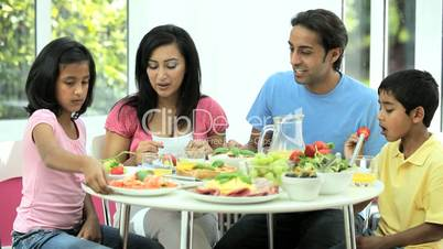 Young Asian Family Sharing Healthy Lunch Together