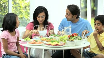 Young Ethnic Family Enjoying a Healthy Meal