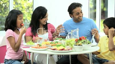 Ethnic Family Eating Healthy Meal