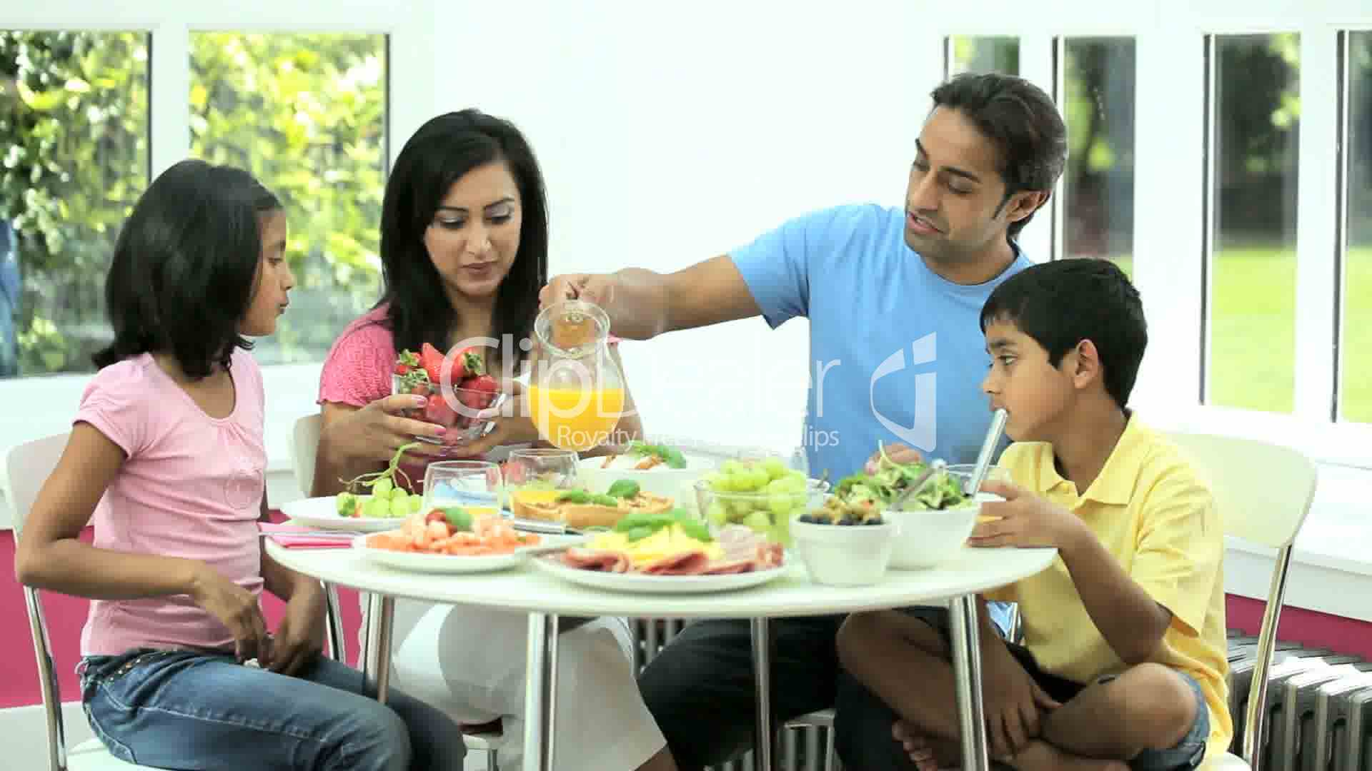 Attractive Asian Family Eating Together Royalty-Free -6570