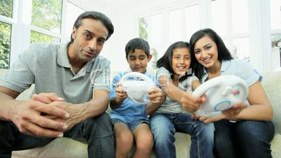Young Ethnic Children Playing on Home Games Console