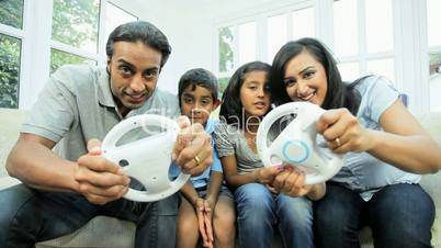 Asian Family Playing with Wireless Games Console