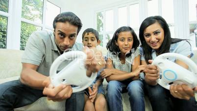 Young Asian Parents Playing on Games Console