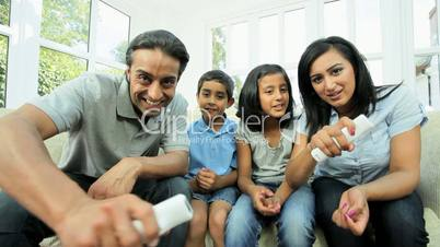 Ethnic Parents Having Fun on Games Console