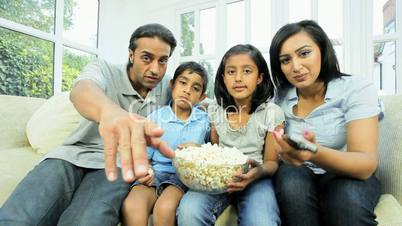 Young Ethnic Family Watching TV with Popcorn