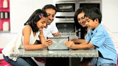 Young Asian Family Using Wireless Tablet