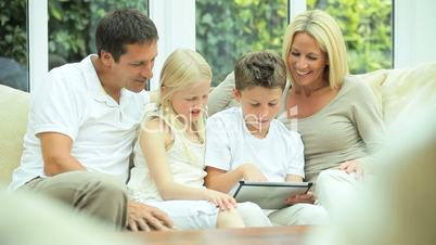 Young Caucasian Family Using Wireless Tablet