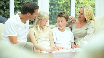 Young Caucasian Family Together at Home