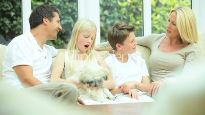 Young Caucasian Family with Pet Dog