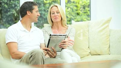 Modern Wireless Tablet Being Used by Caucasian Couple