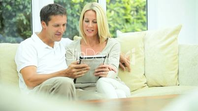 Young Caucasian Couple Using Wireless Tablet at Home