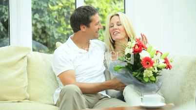 Pretty Blonde Female with Anniversary Bouquet