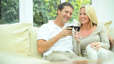 Caucasian Couple at Home Drinking Red Wine