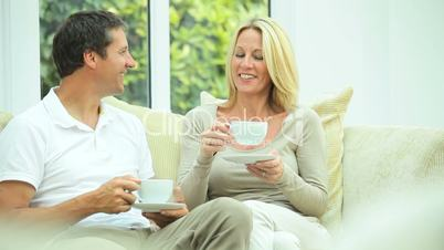 Attractive Couple Relaxing with Cup of Coffee