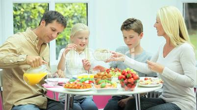 Young Family Eating Healthy Meal