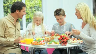 Attractive Young  Family Enjoying a Healthy Meal