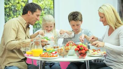 Attractive Caucasian Family Eating Together