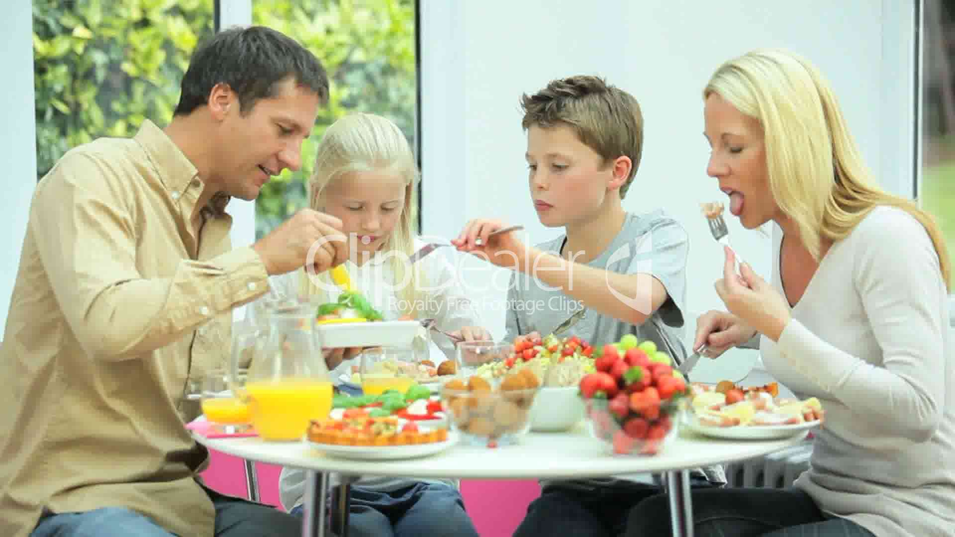 Attractive Caucasian Family Eating Together: Royalty-free ...
