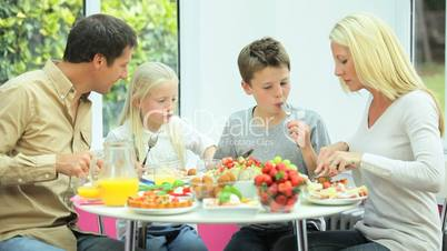 Young Caucasian Family Sharing Healthy Lunch Together