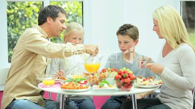 Young Caucasian Family Eating Healthy Lunch Together