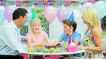 Young Blonde Girl Enjoying Birthday Celebrations