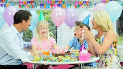 Pretty Caucasian Girl Blowing Out Birthday Candles