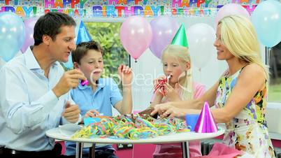 Young Caucasian Children Enjoying Birthday Celebrations