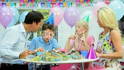 Young Caucasian Family Enjoying Birthday Cake