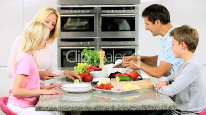 Caucasian Family Preparing Healthy Lunch