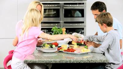 Young Caucasian Children Helping Prepare Healthy Lunch