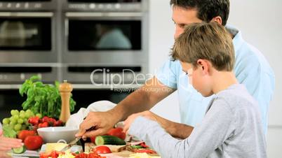 Caucasian Family Preparing Healthy Meal Together