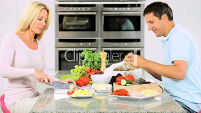 Caucasian Couple in Home Kitchen Preparing Lunch