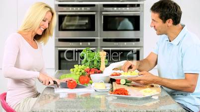 Young Couple Preparing Healthy Lunch