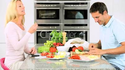 Attractive Couple in Home Kitchen Preparing Lunch