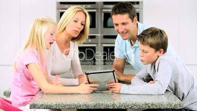 Caucasian Family Playing on Wireless Tablet