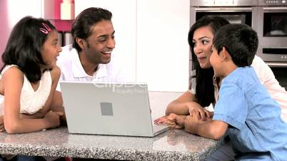Asian Family in Kitchen with Laptop Computer