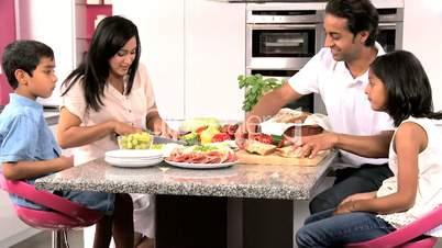 Ethnic Family in Kitchen Preparing Lunch