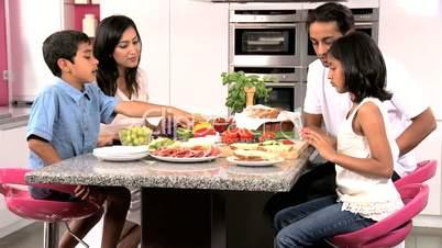 Ethnic Family Enjoying a Healthy Lunch