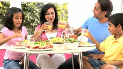 Attractive Asian Family Eating Together